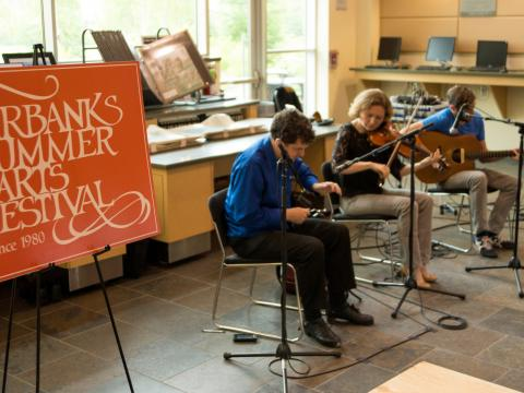 Musicians tuning up at the Fairbanks Summer Arts Festival