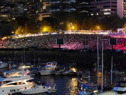 The neon-lit crowd at the Waterfront Blues Festival