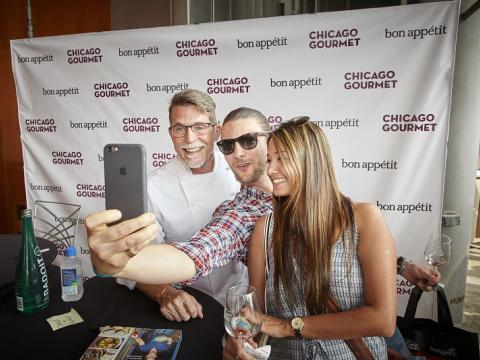 Taking a selfie with celebrity chef Rick Bayless at Chicago Gourmet