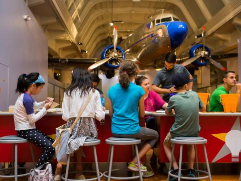 Children tinkering to create projects at The Henry Ford's Maker Faire
