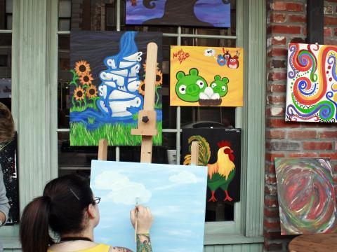 An artist at work during Lake Charles' Spring Art Walk