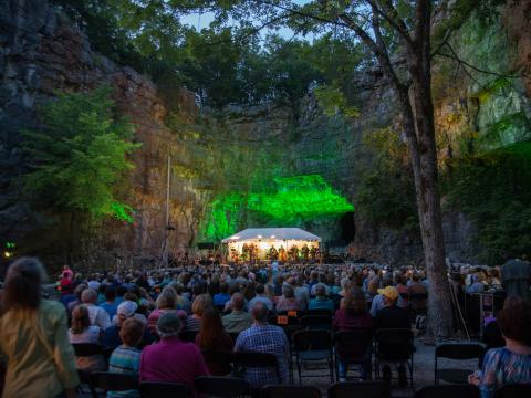 A live music performance in a cave during the Three Caves Concern Series in Huntsville, Alabama